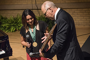 Alumna Norah Jones receives the Presidential Medal of Honor from UNT President Neal Smatresk (Photo by Ahna Hubnik)
