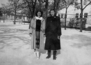 Evelyn, left, and friend Audrey Sommers ('51) in the snow  behind the Harriss Gym, January 1949