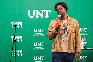 W. Kamau Bell spoke to guests at a Mary Jo and V. Lane Rawlins Fine Arts Series lecture, co-presented as part of UNT's annual Equity and Diversity Conference in February. (Photo by Gary Payne)