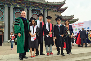 From left, Finley Graves, UNT provost and vice president for academic affairs, with UNT graduates Jiajun Teng ('16), Qi Liu ('16), Binghuan Zhang ('16) and Chen Peng ('16), and UNT-International's program advisor Jiaying 'Cathy' Hu, at June's graduation in China. (Courtesy of UNT-International)