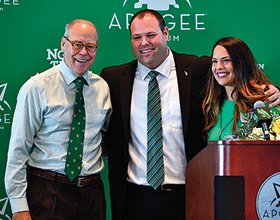 UNT president Neal Smatresk joins new UNT athletic director Wren Baker and his wife Heather at a press conference in Apogee Stadium. (Photo by Michael Clements)
