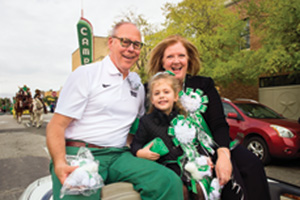 President Neal Smatresk and Debbie Smatresk ride in the UNT Homecoming Parade with their granddaughter. (Photo by Gary Payne)
