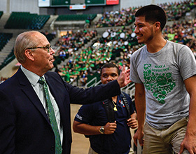 President Neal Smatresk greets students at this fall's New Student Convocation. (Photo by Michael Clements)
