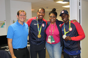 From left to right: Ted Emrich ('09) at the 2016 Rio Summer Olympics with U.S. men's triple jump gold medalist Christian Taylor, NBC Sports commentator Carol Lewis Zilli, and U.S. men's triple jump silver medalist Will Claye.