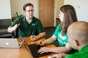 UNT seniors Adam Sharpe, Elizabeth Adams and Erick Cordova discuss their class project that paired them with a Dallas-Fort Worth area business. The three were part of a team that helped the business find logistics solutions, and gave the College of Business students hands-on experience. (Photo by Ahna Hubnik)