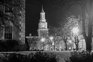 Black-and-white night photo of the Hurley Administration Building
