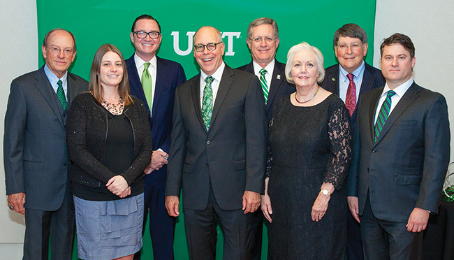 "Pictured with President Neal Smatresk, fourth from left, at the Distinguished Alumni Achievement Awards Dinner are, from left, Jim McNatt ('66), Laura Dominguez ('05), Beau LaMothe ('07), Ben Joyner ('74, '76 M.B.A.), Peggy Rouh ('95 M.S., '01 Ph.D.), Jerome ""Bruzzy"" Westheimer Jr. ('65) and Bryan Milner ('00). (Photo by Kasey Kamenicky ('04)/FW Creations)"