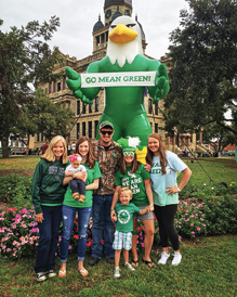 The Larriviere family with Scrappy at the Denton courthouse.