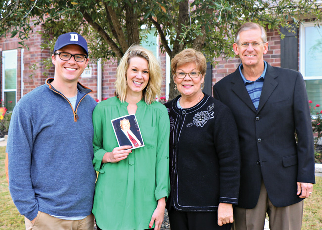 From left, Zach Scheer ('10), Gina Grant Scheer ('10), Liz Millender Grant ('78, '81 M.M.) and Ross Grant ('78, '78 M.M.Ed., '89 Ph.D.). Gina is holding a photograph of her grandfather, Charles Millender ('57, '75 M.M.). (Courtesy of Liz Grant)