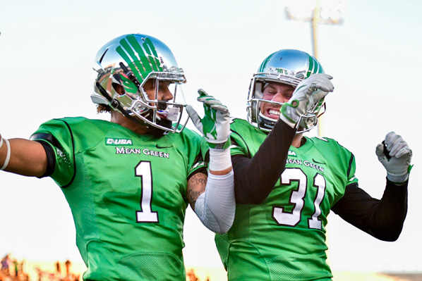 Mean Green Football players celebrate  (Photo by Manny Flores/ Rick Yeatts Photography)
