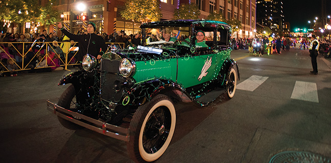Scrappy and members of the Talons spirit organization drove the Mean Green Machine, a 1929 Model A Tudor Sedan, in the 2016 Fort Worth Parade of Lights in Sundance Square in November. (Photo by Gary Payne)