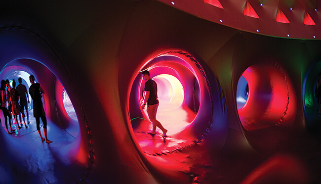 This spring UNT's Mary Jo & V. Lane Rawlins Fine Arts Series presented Luminarium on the south lawn of the University Union, a maze of winding paths and soaring domes from Islamic architecture, Archimedian solids and Gothic cathedrals that yield varying light patterns. (Photo by Ahna Hubnik)