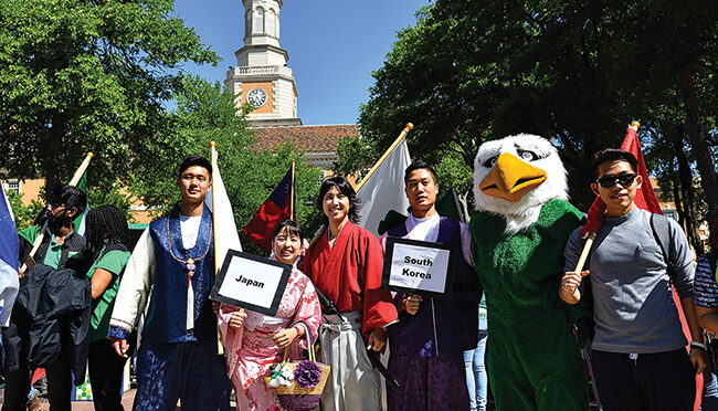Students from 129 countries call UNT home and participated in the annual Flag Parade during 2017 University Day celebrations. (Photo by Michael Clements)