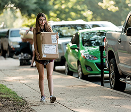 Student moving into a residence hall