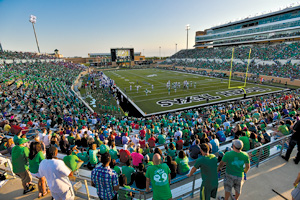 UNT's Apogee Stadium holds 31,000 fans and has eco-friendly features like wind turbines, unlike any collegiate stadium in the nation. Opened in 2011, it was the first newly constructed college football stadium to earn LEED Platinum certification. (Photo by Gary Payne)