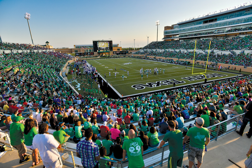 Fans at Apogee Stadium near sunset
