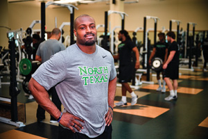 Former Mean Green player Jamize Olawale, now a fullback for the NFL's Oakland Raiders, is working out with the football team this spring. (Photo by Michael Clements)