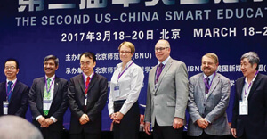 College of Information Dean Kinshuk, left, and UNT President Neal Smatresk, second from right, attended the U.S.-China Smart Education Conference in Beijing, China, this spring. (Photo by Edem Dahlstrom)