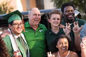 President Neal Smatresk celebrates the Class of 2017 at the inaugural UNT Graduation Block Party. (Photo by Ahna Hubnik)