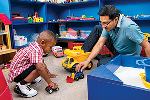 Gustavo Barcenas ('17 Ph.D.) volunteers at UNT's Center for Play Therapy (Photography by Ahna Hubnik)