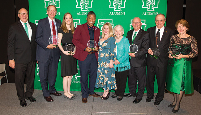 Pictured at the Distinguished Alumni Achievement Awards Dinner are, from left, President Neal Smatresk, Don Millican ('74), Emily Mauzy ('06, '06 M.S.), Elliotte Dunlap ('97), Sarah Mickelson ('05), Mary Lu Waddell, Stephen 'Steve' F. Waddell ('75, '96 Ed.D.), Jim Fincher ('69) and Gayle W. Strange ('67). (Photo by Kasey Kamenicky ('04)/FW Creations)