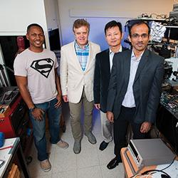 Zeke Walker ('12 M.S., '14 Ph.D., '16 M.B.A.), Arkadii Krokhin, Tae-Youl Choi and Arup Neogi. (Photo by Gary Payne)