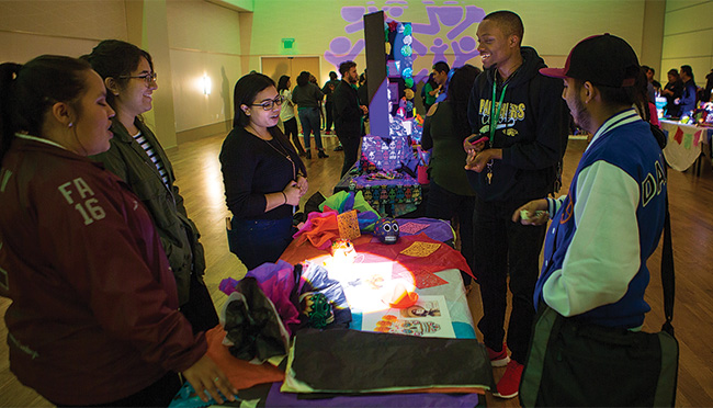 UNT students painted sugar skulls as part of the Dia de los Muertos celebration on campus Oct. 31. The festival in the University Union featured altars with ofrendas made by different student organizations. (Photo by Kara Dry)