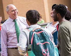 President Neal Smatresk visits with students during the Homecoming Picnic. (Photo by Ahna Hubnnik)
