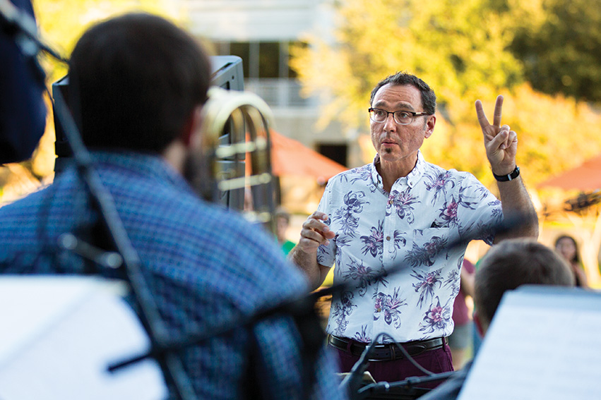 Alan Baylock conducts outdoors at the Frisco Art Walk