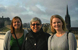 From left, Lucy Ledue ('12), Cynthia Mohr, design associate professor and chair, and Amanda Halston ('12) enjoy the view from the roof of the Museum of Scotland, overlooking Edinburgh Castle.
