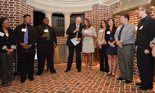 President V. Lane Rawlins, surrounded by Emerald Eagle Scholars, speaks to the crowd at the kickoff event about the importance of the program, which helps academically talented students with high financial need attend college. (Photo by Michael Clements)