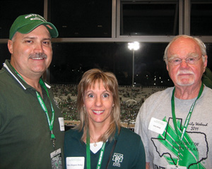 "From left, Robert Kirkpatrick ('86), Mary Margaret ""Maggie"" Bishop Kirkpatrick ('84) and Robert ""Harry"" Bishop ('53) during Family Weekend at UNT's Apogee Stadium."