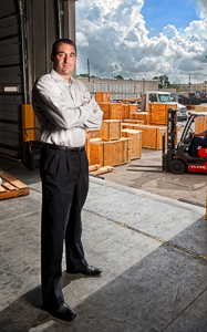 John Magee ('94) has helped build Crane Worldwide Logistics into a global trade and transportation powerhouse in 19 countries. (Photo by Angilee Wilkerson)
