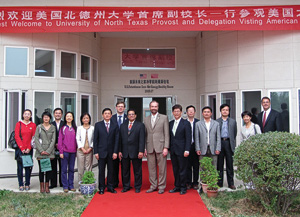 A delegation of UNT leaders and faculty at the American House, a net-zero energy home and model of energy efficiency in Beijing, China.