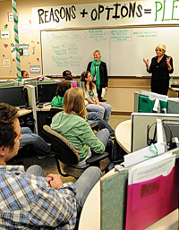 President Gretchen M. Bataille talks with Call Mean Green students. (Photo by Michael Clements)