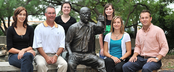 Members of UNT's Office of Sustainability appear with a statue honoring J.K.G. Silvey at the Environmental Education Science and Technology Building. From left, Lauren Helixon, graduate student; Todd Spinks, director of the Office of Sustainability; Paige Burgess, graduate student; Lauren Lesch, graduate student; Erin Davis, assistant to the director of the Office of Sustainability; Brandon Morton, graduate student.