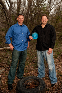 Tim Sommers ('98) and Eric Baumgart work to clean up scrap tire materials from illegal tire dumps through their environmental cleanup company TERC LLC. (Photo by Angilee Wilkerson)