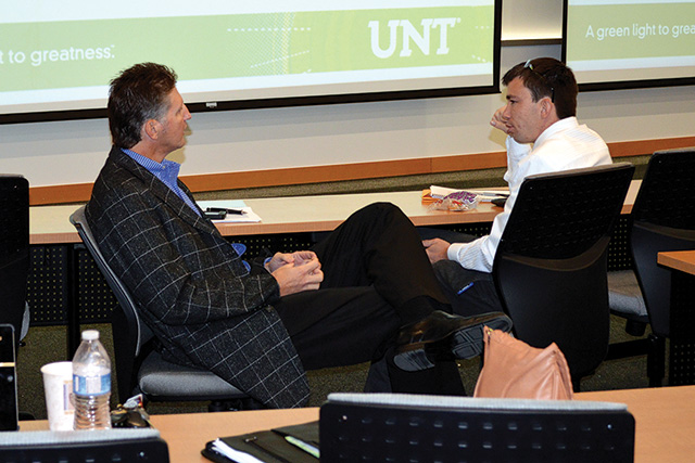 Finance and operations management senior Roy Mannix, right, meets with his mentor, Ray White, chief performance officer/partner at Dallas-based Reinvention, through the Professional Leadership Program. (Photo by Janae Denman)