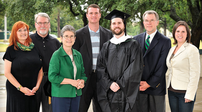 From left, Kristin Williamson, David Williamson, Celia Williamson, Kevin McGill ('07), Sam Williamson ('12 M.A.), Tim Williamson ('85 M.S.), Emily Williamson McGill ('06, '08 M.P.A.)  (Photo by Jonathan Reynolds)
