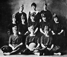 Women's basketball coach Beulah Harriss (top center) poses with the 1918-19 North Texas team.