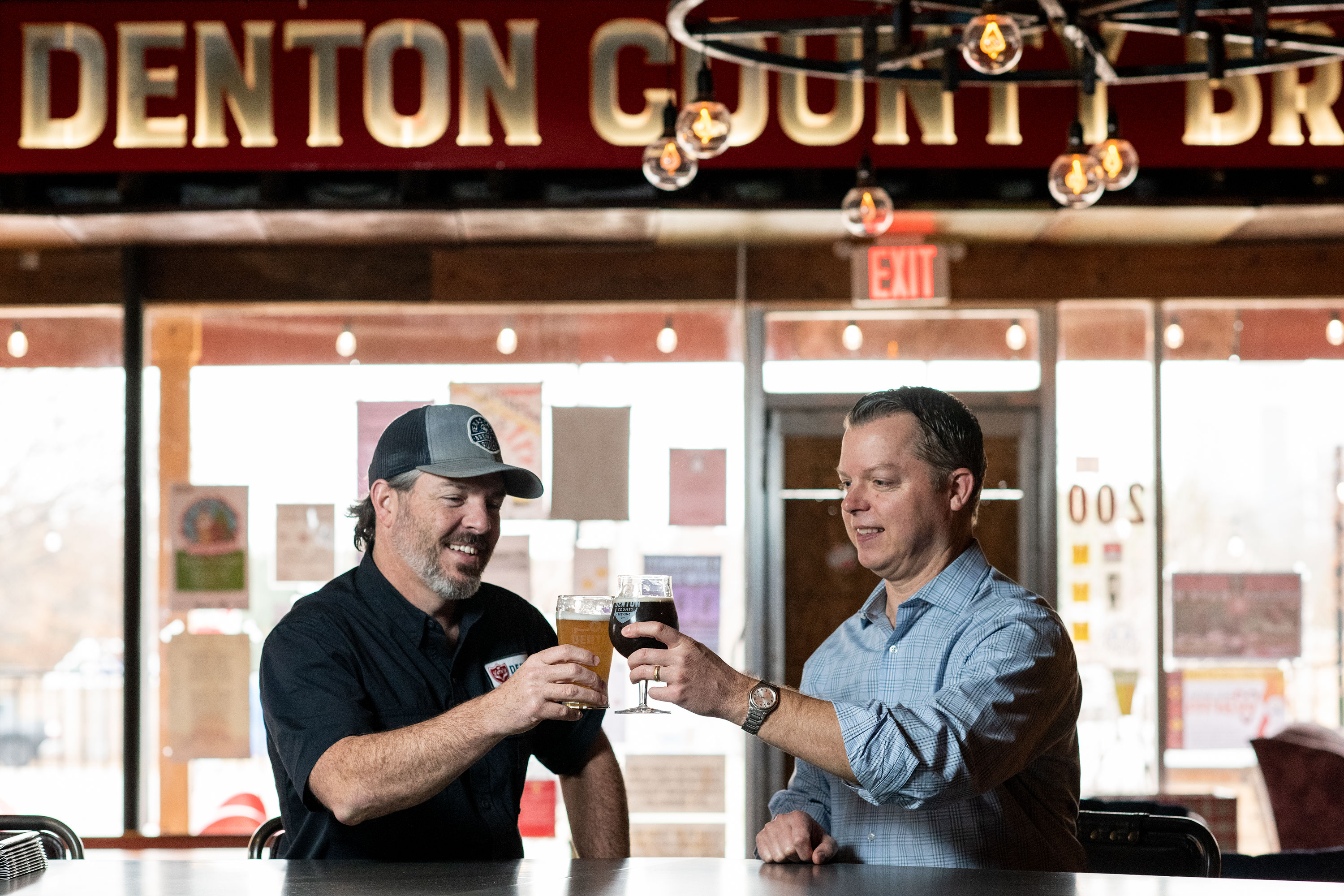 Seth Morgan and Mike Barnett inside Denton County Brewing Co.