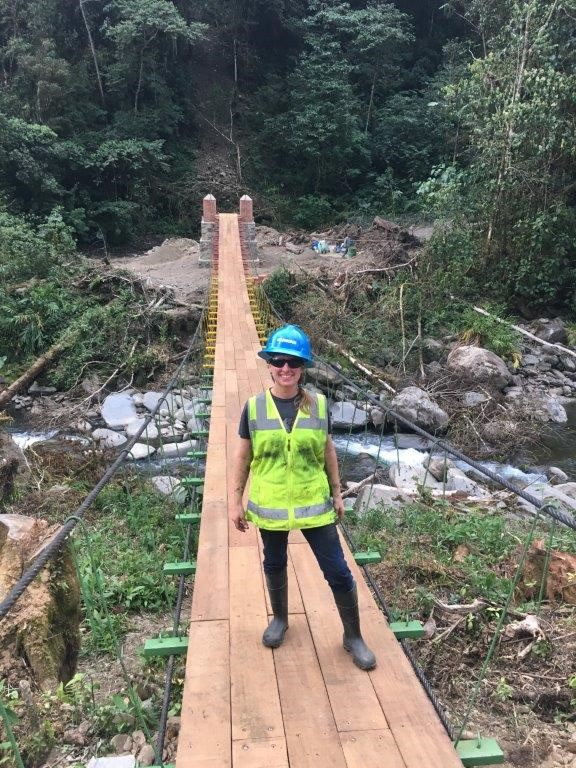 Sara Cederburg stands on a completed footbridge