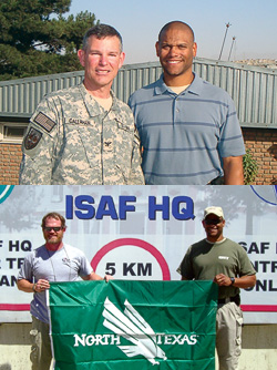 Top, from left, Capt. Kevin Callahan, U.S. Navy, UNT associate professor of educational psychology, and Anthony Carter ('94). Bottom, from left, Deputy U.S. Marshal Paul Denton ('91) and Anthony Carter.