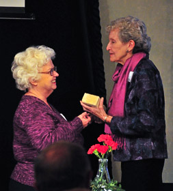 Chemistry faculty member Diana Mason, left, presents a brick from Masters Hall to Catherine Dawson, granddaughter of W.N. Masters.