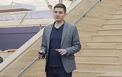 Photo of Matt Artz standing in front of stairs