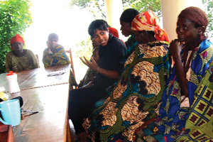 Sarah Broom ('02), executive director of Village Health Works, meets with women at the clinic in Kigutu, Burundi, to hear about their lives and discuss ways they might work together to improve them. (Courtesy of Village Health Works)