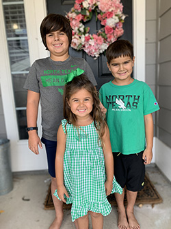 """Photo of Jacob, Madeline and Josh Rodriguez wearing outfits with """"North Texas"""" text"""