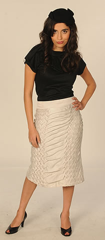 Shirin Askari shows off one of her designs.  <em>Photo courtesy of Lifetime Television.</em>