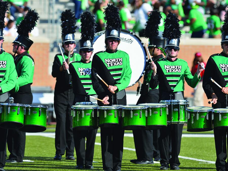 Green Brigade drumline performing at game