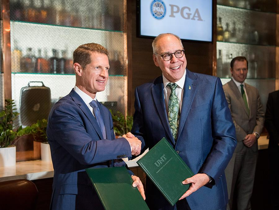 PGA Chief Operating Officer Darrell Crall and UNT President Neal Smatresk